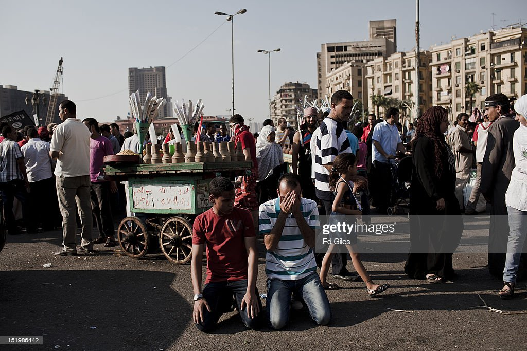 Egyptian protesters perform afternoon prayers during a protest following midday prayers in Tahrir Square on September 14, 2012 in Cairo, Egypt. Over two hundred people have been injured in clashes between protesters and security forces. Protests have continued into a fourth day in central Cairo, with Egyptians demonstrating against a US-made film said to be defaming the Prophet Mohammed, whose trailer had recently been released on Youtube and translated into Arabic. Egyptian authorities began construction of a concrete barrier early Friday morning to stop demonstrations planned across the country for Friday from reaching the US Embassy, after Egyptians demonstrated at the Embassy compound and breached its perimeter walls on Tuesday.