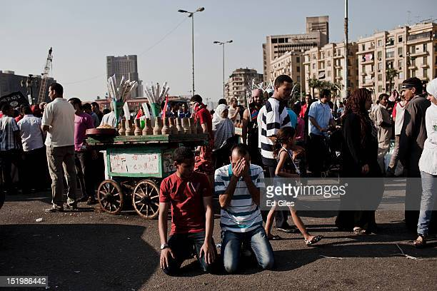 Egyptian protesters perform afternoon prayers during a protest following midday prayers in Tahrir Square on September 14 2012 in Cairo Egypt Over two...