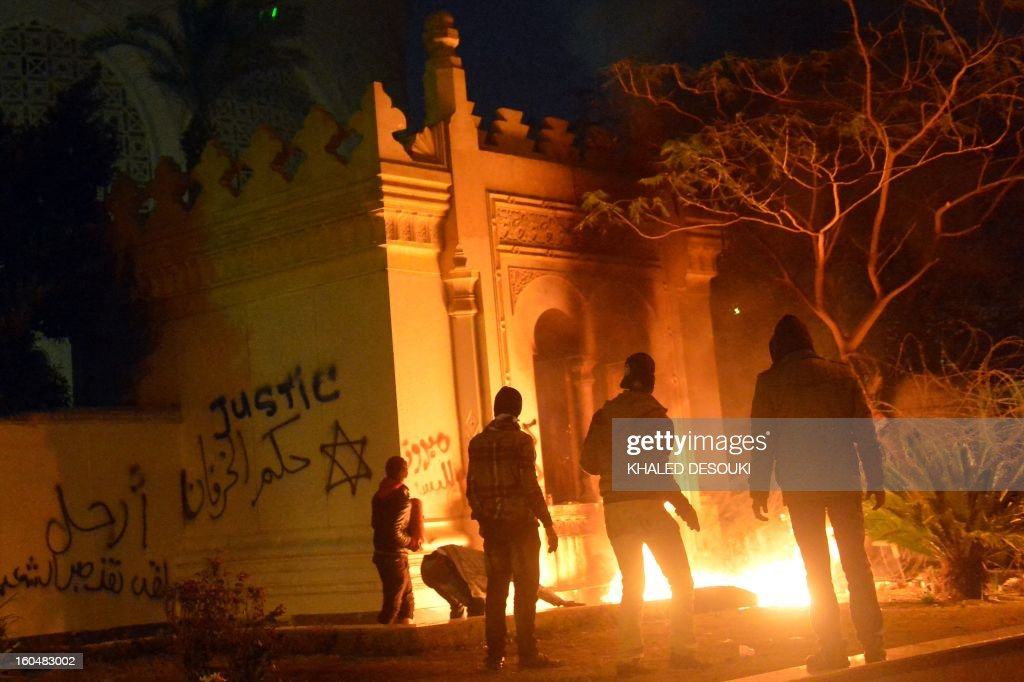 Egyptian protesters set fire to the gate of the presidential palace in Cairo on February 1, 2013, as people took to the streets across the country in a show of opposition to Morsi and his Muslim Brotherhood. Egyptian security used water cannon and fired shots into the air as protesters threw petrol bombs and stones into the grounds of the presidential palace, an AFP correspondent said.