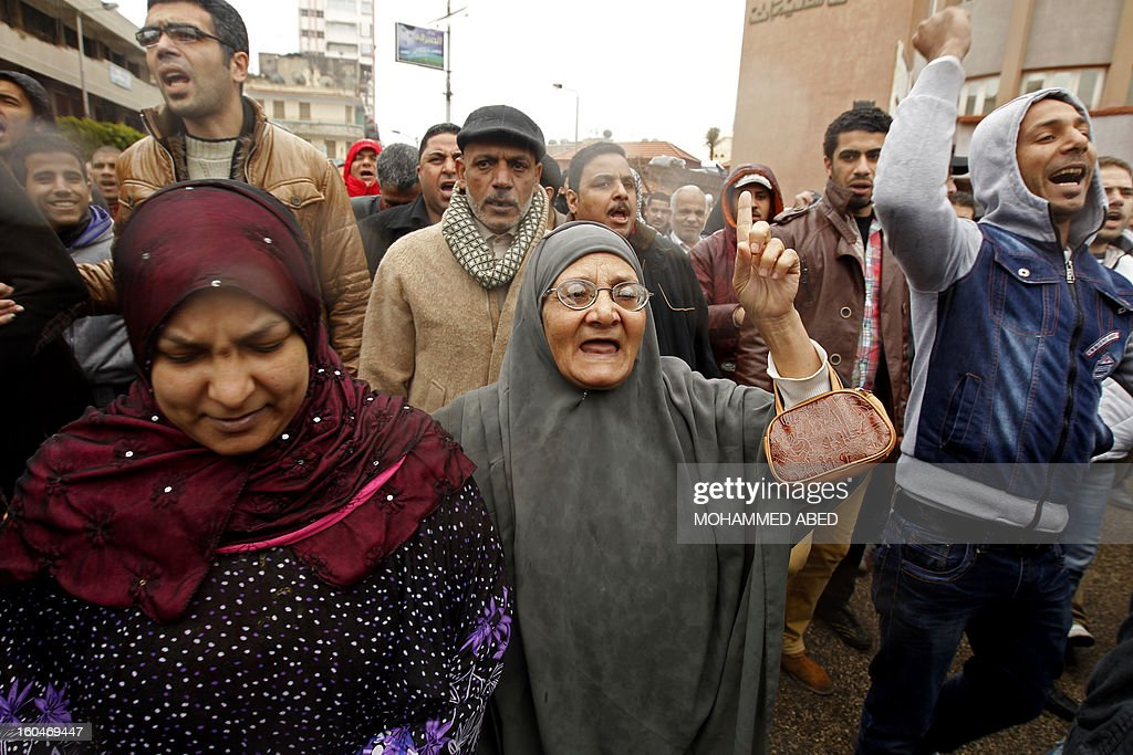 Egyptian protesters shout slogans against Egypt's President Mohamed Morsi during a demonstration after Friday prayers in Port Said on February 1, 2013. Thousands of Egyptians flooded the streets in a show of opposition to the Islamist President and his Muslim Brotherhood after a week of a wave of deadly unrest swept the country. AFP PHOTO/MOHAMMED ABED