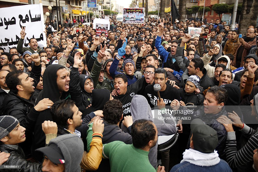 Egyptian protesters shout slogans against Egypt's President Mohamed Morsi during a demonstration after Friday prayers in Port Said on February 1, 2013. Thousands of Egyptians flooded the streets in a show of opposition to the Islamist President and his Muslim Brotherhood after a week of a wave of deadly unrest swept the country.