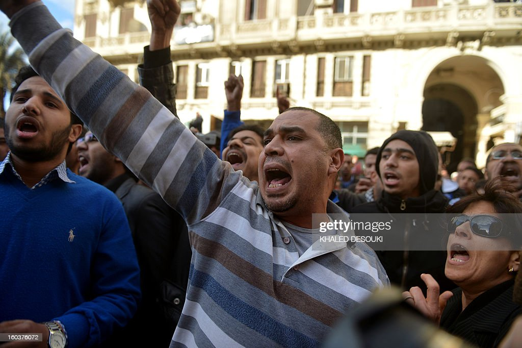 Egyptian protesters shout slogans against President Mohamed Morsi during a demonstration outside the high court in central Cairo on January 30, 2013. Egyptian opposition leaders called for urgent talks on the political crisis gripping the country, as a fresh eruption of violence killed two more people in Cairo.