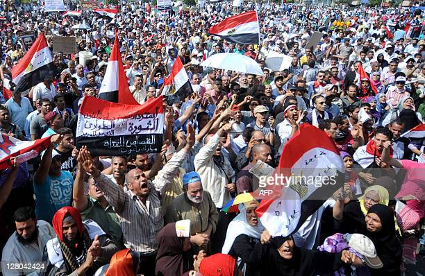 Egyptian protesters shout slogans as they gather in Cairo's Tahrir Square on September 30 2011 during a mass rally to reclaim the revolution amid...