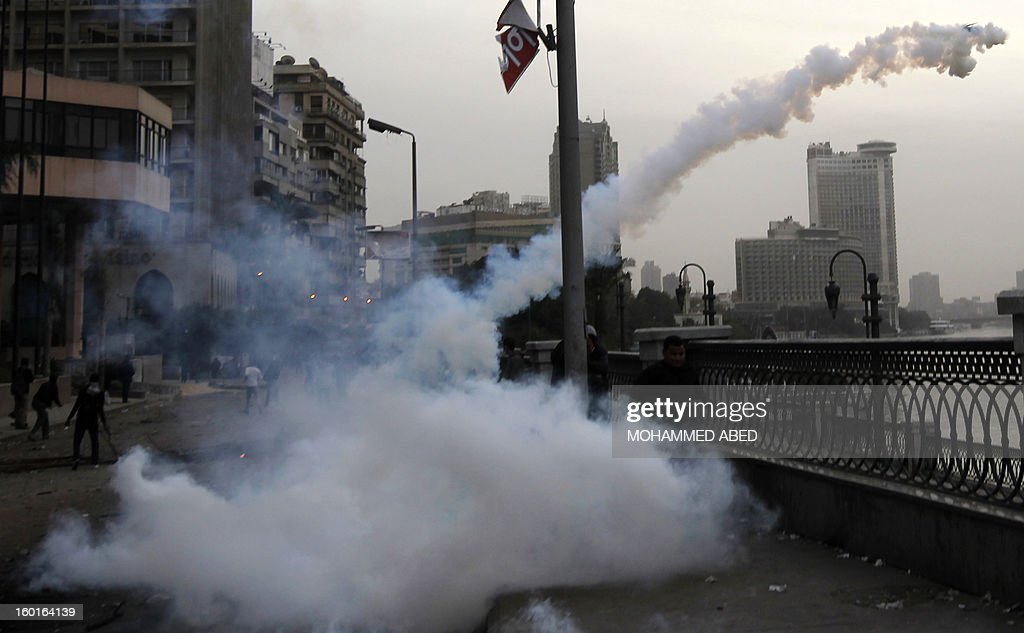 Egyptian protesters stand among the smoke of tear gas canisters during clashes near Cairo's Tahrir Square on January 27, 2013. Clashes killed at least 31 people in Egypt's Port Said as violence raged in several cities including the capital following death sentences passed on 21 football fans after a riot.