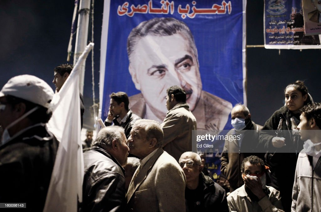 Egyptian protesters standbelow a poster of former secular Egyptian President Gamal Abdel Nasser during a demonstration in Tahrir Square on January 25, in Cairo, Egypt. Thousands of protesters converged on the capital's iconic Tahrir Square on January 25, to mark the second anniversary of the overthrow of former President Hosni Mubarak's regime. (Photo by Ed Giles/Getty Images).