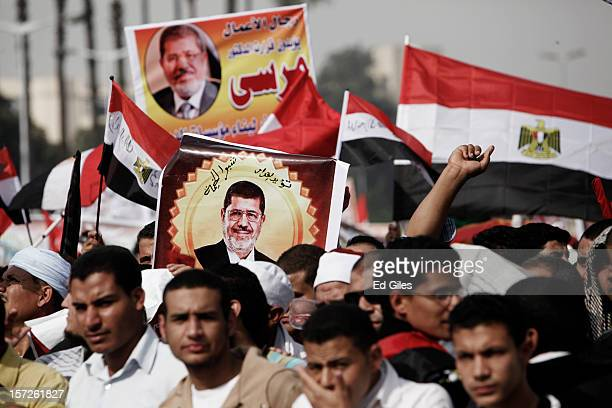 Egyptian protesters take part in a demonstration supporting Egyptian President Mohammed Morsi infront of Cairo University on December 30 in Cairo...