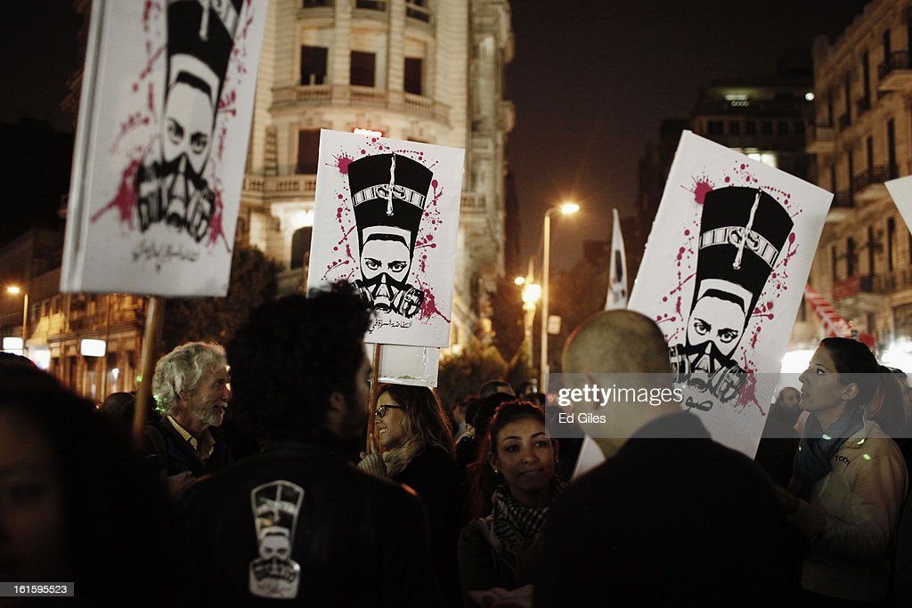 Egyptian protesters take part in a march against sexual harassment at Talat Harb Square, on February 12, 2013 in central Cairo, Egypt. A few hundred Egyptian men and women gathered at the Egyptian capital's Talat Harb Square on Tuesday to demonstrate against the continuing problem of sexual harassment of Egyptian and foreign women during demonstrations across Egypt. (Photo by Ed Giles/Getty Images).