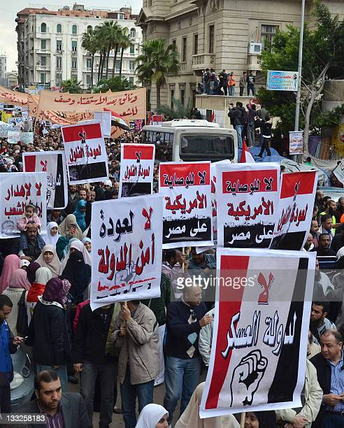 Egyptian protesters take part in a rally holding up posters written in Arabic calling against US intervention in the coastal city of Alexandria on...