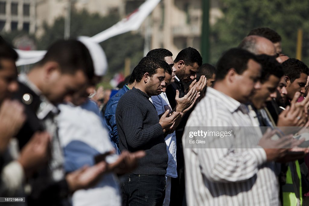 Egyptian protesters take part in midday prayers in Tahrir Square on November 30, 2012, in Cairo, Egypt. Demonstrations continue in Cairo today after Egypt's Constituent Assembly finalised a draft of the country's new constitution in an overnight voting session late last night. Violent protests have continued for over ten days across the country in response to Egyptian president Mohammed Morsi having awarded himself new constitutional powers, which many believe have been pushed through by the Muslim Brotherhood without inclusive consultation with other members of Egypt's cabinet and political leadership. (Photo by Ed Giles/Getty Images).