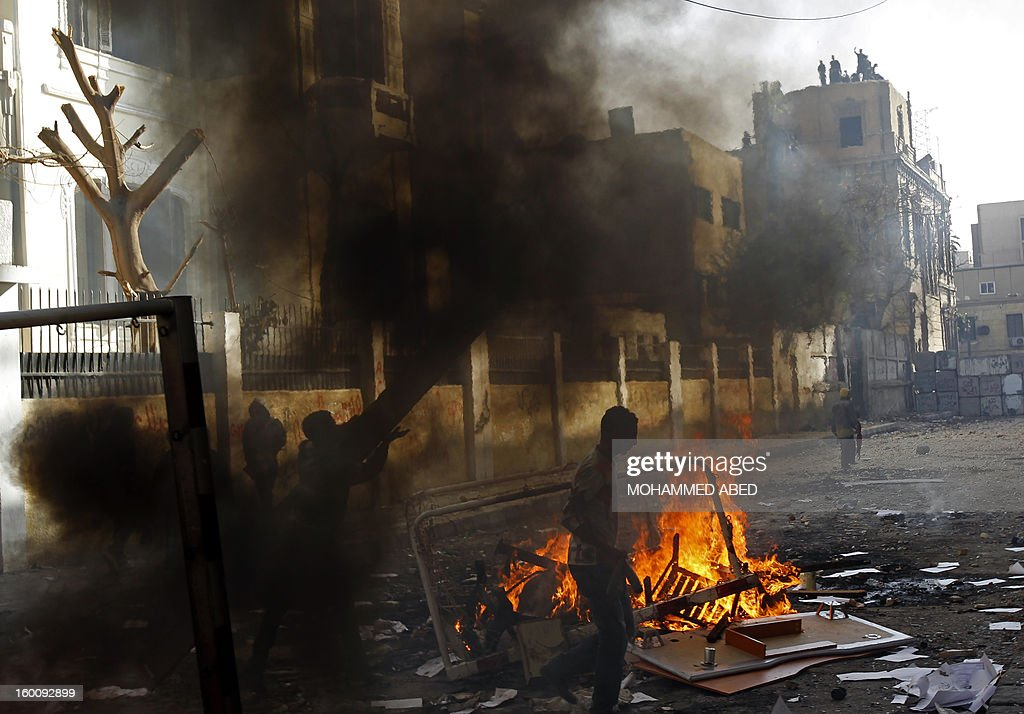 Egyptian protesters throw stones towards riot police during a demonstration in Cairo's Tahrir Square on January 26, 2013. Egypt's Islamist President Mohamed Morsi appealed for calm after at least seven people were killed in violence on the second anniversary of the revolution that ousted Hosni Mubarak. AFP PHOTO/MOHAMMED ABED