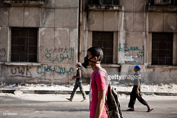 Egyptian protesters walk towad police lines during clashes near the United States Embassy and Cairo's Tahrir Square on September 13 2012 in Cairo...