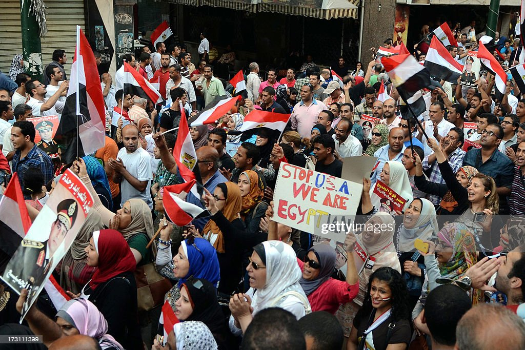 Egyptian protesters wave national flags during a demonstration against deposed President Mohamed Morsi on July 7, 2013 in the northern Egyptian city of Alexandria. In the capital, opponents of Morsi packed Tahrir Square in their tens of thousands to show the world his ouster was not a military coup but the reflection of the people's will. AFP PHOTO/ STR