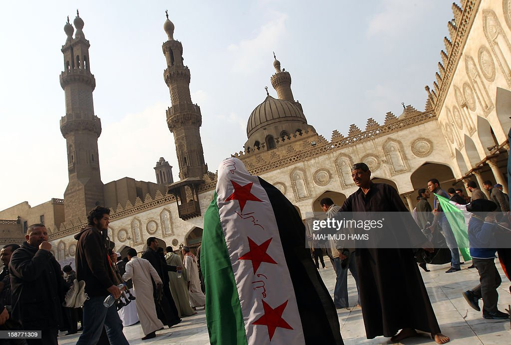 Egyptian protestors gather during a rally in support of the Syrian people and against Syria's President Bashar al-Assad at Al-Azhar mosque in Cairo, on December 28, 2012. Syrian warplanes launched air raids in Damascus province after overnight bombardments and clashes across the country, the Syrian Observatory for Human Rights said.