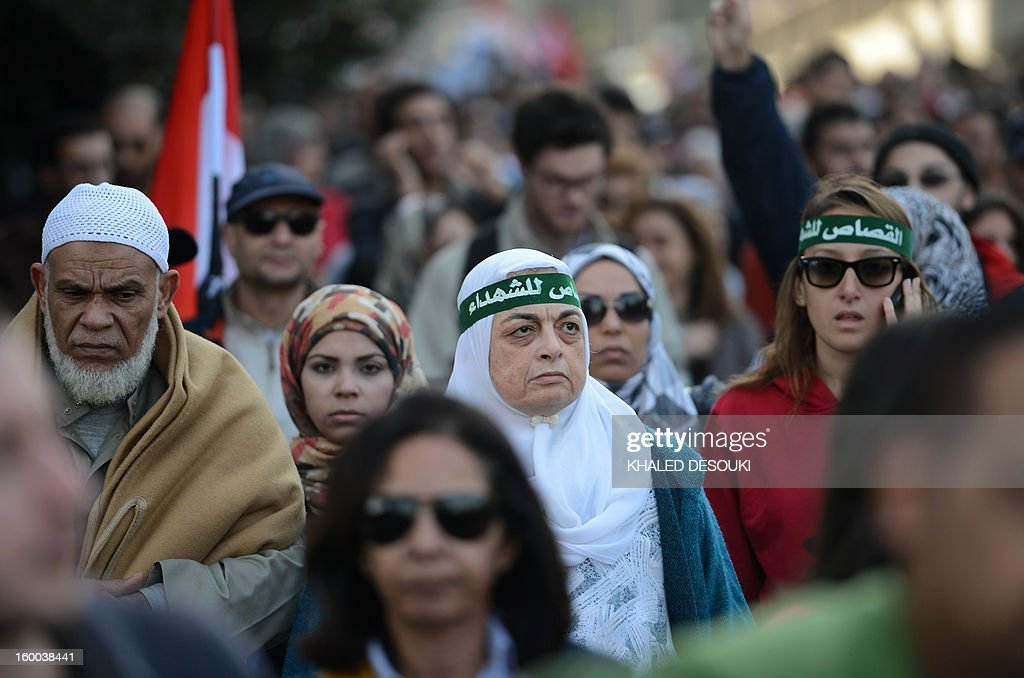 Egyptian protestors march in Cairo's Tahrir Square on January 25, 2013, during a demonstration to demand change, two years after the uprising that ousted Hosni Mubarak and ushered in an Islamist government, as sporadic clashes erupted nearby.