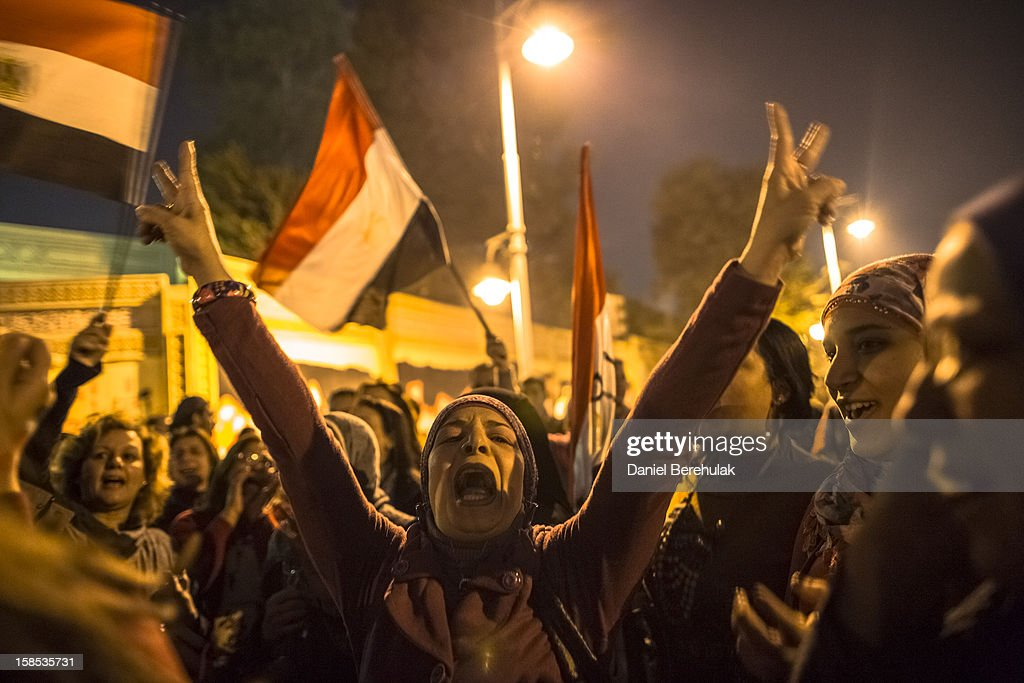 Egyptian protestors opposing president Mohammed Morsi chant slogans during a demonstration at the Presidential Palace on December 18, 2012 in Cairo, Egypt. Hundreds of people gathered in front of the Presidential Palace and in Tahrir Square to protest against President Mohammed Morsi and the alleged rigging of the first round of voting in the constitutional referendum.