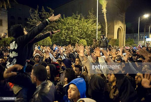 Egyptian protestors shout slogans as they demonstrate in the streets of the canal city of Port Said late on January 28 breaking the curfew the...