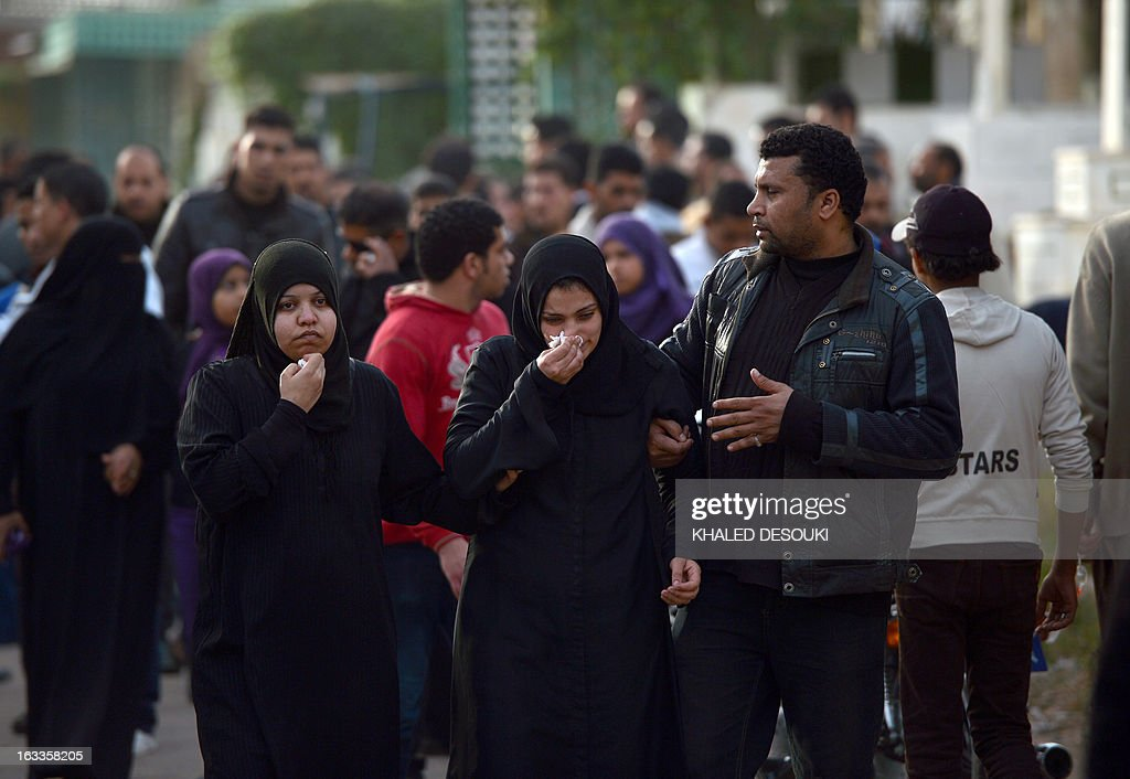 Egyptian relatives and friends mourn over the death of Abdelhalim Mehana who was killed during clashes with riot police on March 4, during his funeral in the Suez Canal city of Port Said on March 8, 2013, a day before a court is to issue verdicts over the killing of people in a football riot there. AFP PHOTO / KHALED DESOUKI