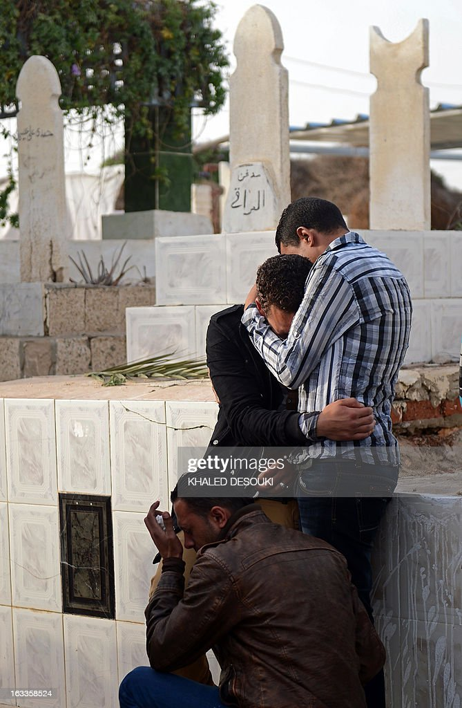 Egyptian relatives and friends mourn over the death of Abdelhalim Mehana who was killed during clashes with riot police on March 4, during his funeral procession in the Suez Canal city of Port Said on March 8, 2013, a day before a court is to issue verdicts over the killing of people in a football riot there.