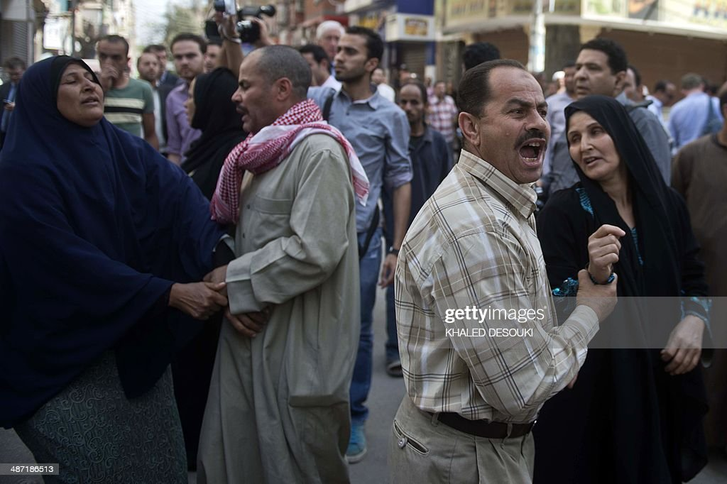 Egyptian relatives reacts outside the courtroom in Egypt's central city of Minya after an Egyptian court sentenced Muslim Brotherhood leader Mohamed Badie and other alleged Islamists to death on April 28, 2014. The defendants were accused of involvement in the murder and attempted murder of policemen in Minya province on August 14, the day police killed hundreds of ousted Islamist president Mohamed Morsi's supporters in clashes in Cairo.