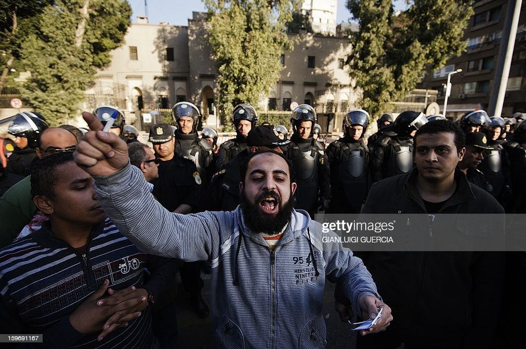 Egyptian riot police cordon off the area in front of the French embassy in Cairo as an Egyptian protester shouts anti-western slogans during a demonstration organised by Egyptian Islamists against the French intervention in Mali on January 18, 2013.