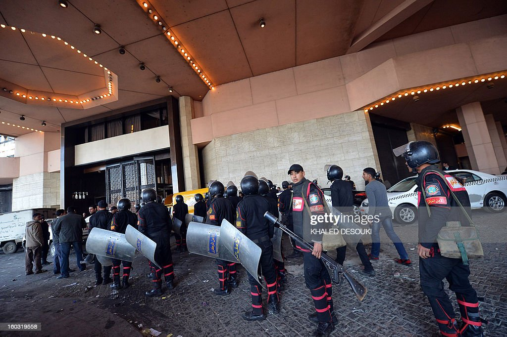 Egyptian riot police deployed outside of the Semiramis Intercontinental Hotel after it was vandalized when protestors stormed the entrance last night, in central of Cairo on January 29, 2013. Egypt's military chief warned that the political crisis sweeping the country could lead to the collapse of the state, as thousands defied curfews and the death toll from days of rioting rose to 52.
