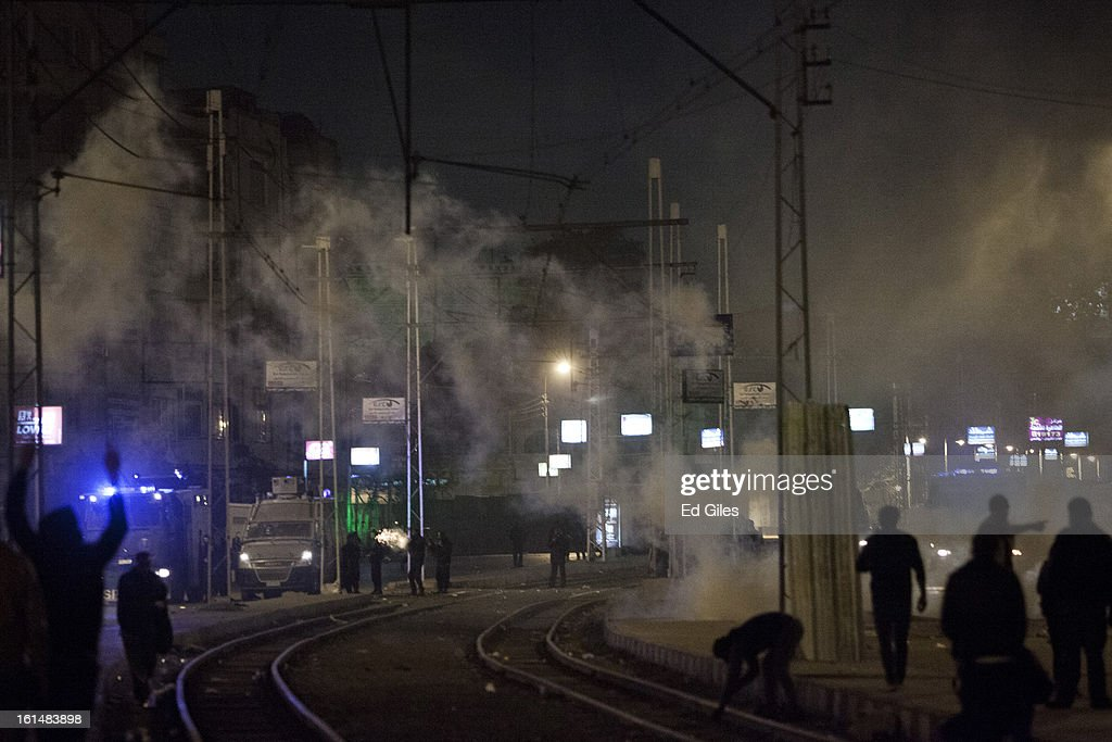 Egyptian riot police fire tear gas toward nearby protesters during violent protests by the Presidential Palace in Heliopolis, February 11, 2013 in Cairo, Egypt. Protests continued across Egypt against President Morsi and the Muslim Brotherhood on the 2nd anniversary of former President Hosni Mubarak stepping down, and over two weeks after the second anniversary of the Egyptian Revolution beginning on January 25, 2011. (Photo by Ed Giles/Getty Images).
