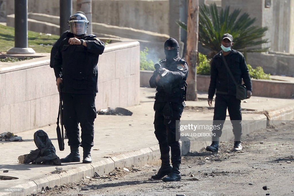 Egyptian riot police fires a tear gas canister towards protesters during clashes near Cairo's Tahrir Square, on January 29, 2013. Egypt's military chief warned that the political crisis sweeping the country could lead to the collapse of the state, as thousands defied curfews and the death toll from days of rioting rose to 52.
