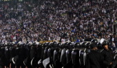 Egyptian riot police stand guard in Cairo Stadium during the first half of a match between Zamalek and Ismaili clubs in Cairo on February 1 2012 At...
