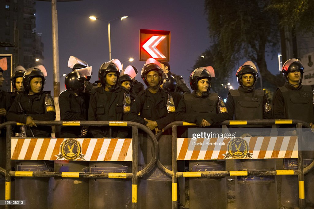 Egyptian riot police stand guard in front of Dokki police station on December 16, 2012 in Cairo, Egypt. Egyptian police were on high alert after news of a planned protest by Salafist supporters of Hazem Abu Ismail, after an attack on WAFD party headquarters last night on election day. The protest was cancelled after an announcement on Hazem Abu Ismail's Facebook account.