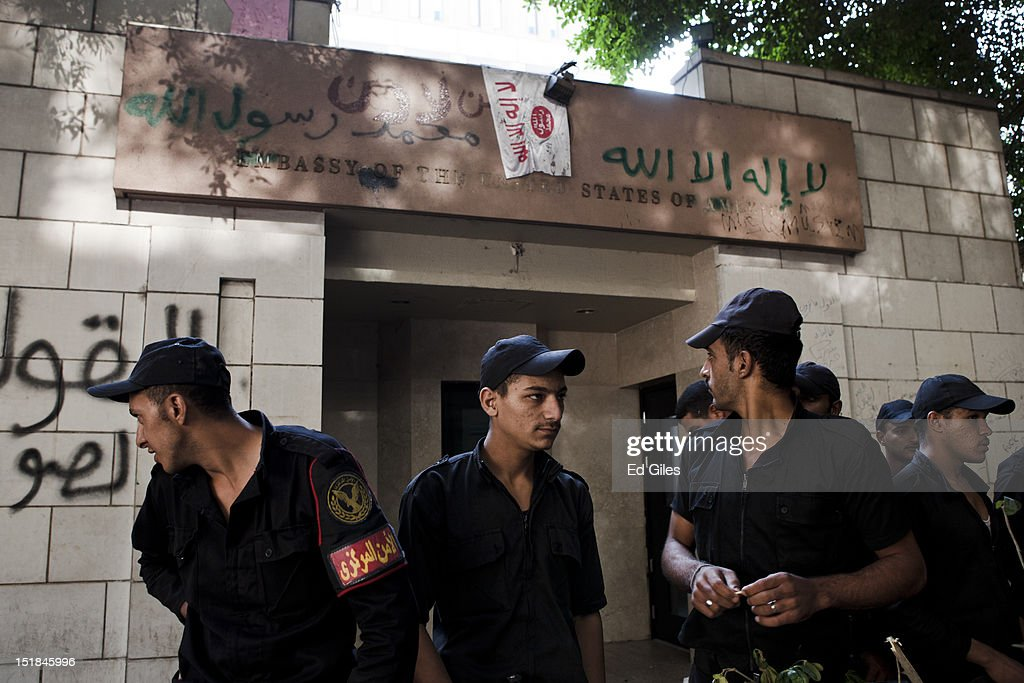 Egyptian riot police stand guard in front of United States Embassy the morning after it was vandalised by protesters during a demonstration on...