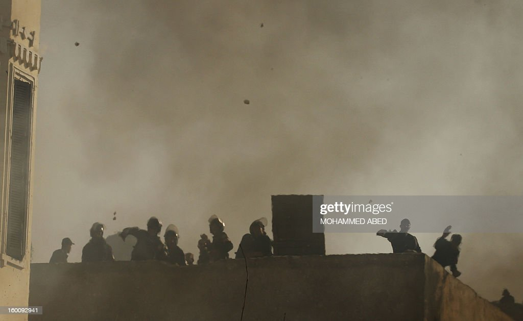 Egyptian riot police throw stones towards protesters during a demonstration in Cairo's Tahrir Square on January 26, 2013. Egypt's Islamist President Mohamed Morsi appealed for calm after at least seven people were killed in violence on the second anniversary of the revolution that ousted Hosni Mubarak.