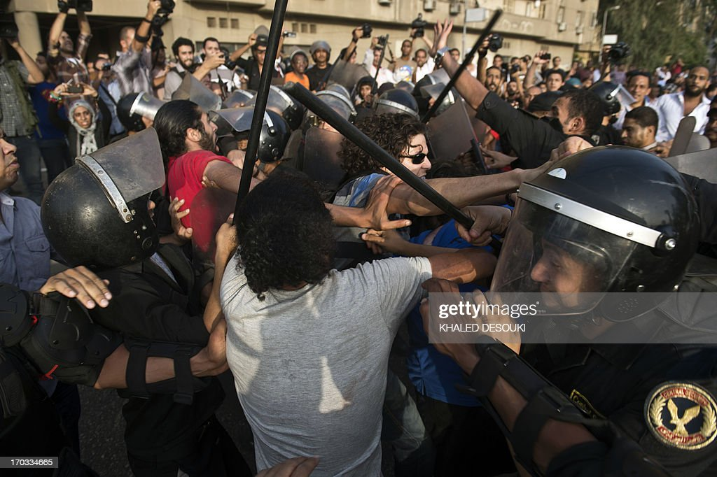 Egyptian riot police try to disperse clashes between supporters the ruling Muslim Brotherhood and protestors calling for the resignation of Culture...