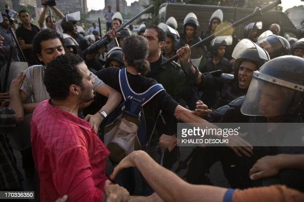 Egyptian riot police try to end clashes between supporters the ruling Muslim Brotherhood and protestors calling for the resignation of Culture...
