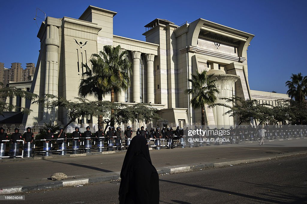 Egyptian riot policemen cordon off the area of the Supreme Constitutional Court (SCC) on the banks of the Nile in Cairo ahead of a court rule on the legality of an Islamist-dominated panel that drafted the country's constitution, on January 15, 2013. Egypt's top court was to rule whether Egypt's Islamist-dominated Senate should be dissolved as well as on the validity of a panel that wrote the country's controversial constitution. Dozens staged a sit-in overnight outside the Supreme Constitutional Court (SCC) on the banks of the Nile in Cairo, as riot police formed a cordon around the building.