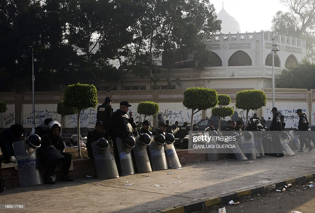 Egyptian riot policemen deploy outside the presidential palace in Cairo on February 2, 2013 after a night of clashes between security forces and anti-government protesters. Egyptian riot police deployed near the presidential palace after a night of clashes between security forces and petrol-bomb throwing protesters that killed at least one man and wounded dozens.