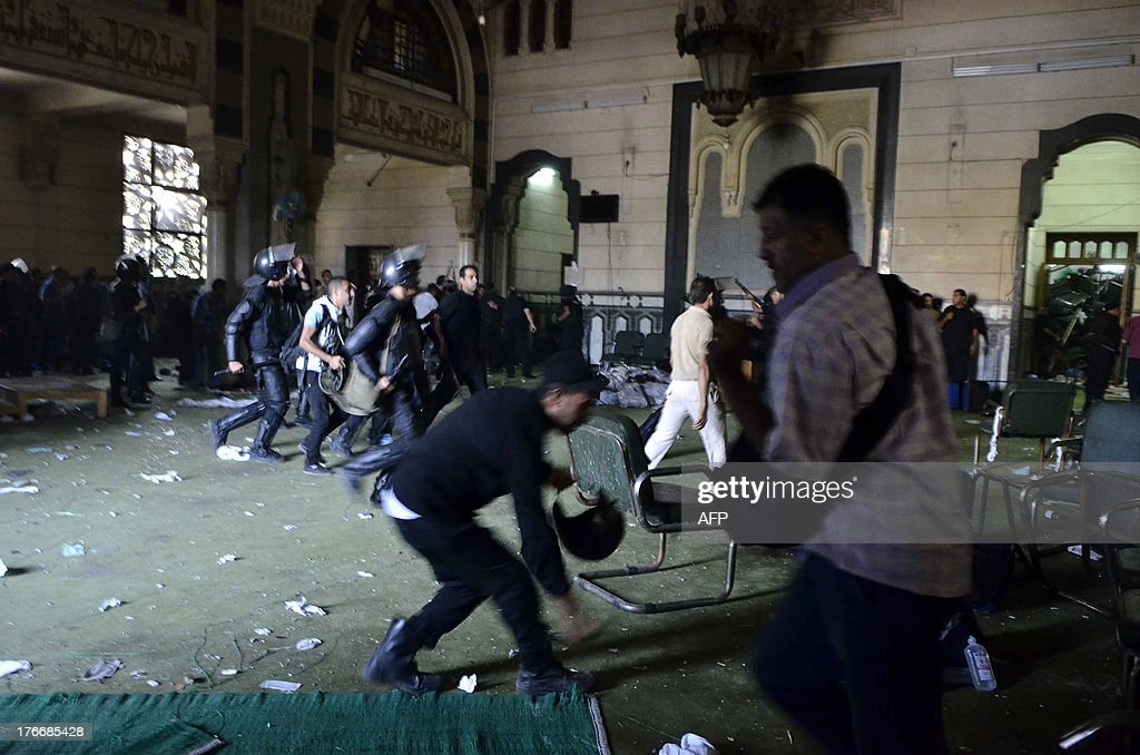 Egyptian riot policemen get in the community services hall of Cairo's Al-Fath mosque where Islamist supporters of ousted president Mohamed Morsi held up on August 17, 2013. The standoff at al-Fath mosque in central Ramses Square began on August 16, with security forces surrounding the building where Islamists were sheltering and trying to convince them to leave.