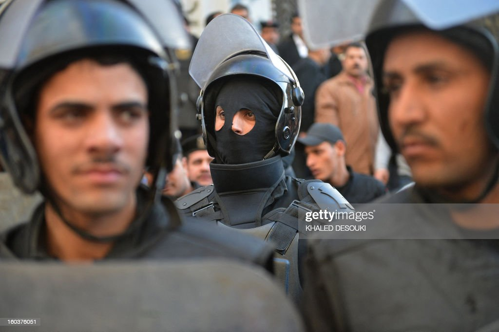 Egyptian riot policemen stand guard during a demonstration outside the high court in central Cairo on January 30, 2013. Egyptian authorities detained suspected 'Black Bloc' members as they protested an order by the public prosecutor to arrest anyone from the shadowy opposition group, an AFP journalist said. Presenting themselves as the defenders of protesters opposed to President Mohamed Morsi's rule, the Black Bloc reportedly models itself on anarchist groups of the same name in Europe and the United States.