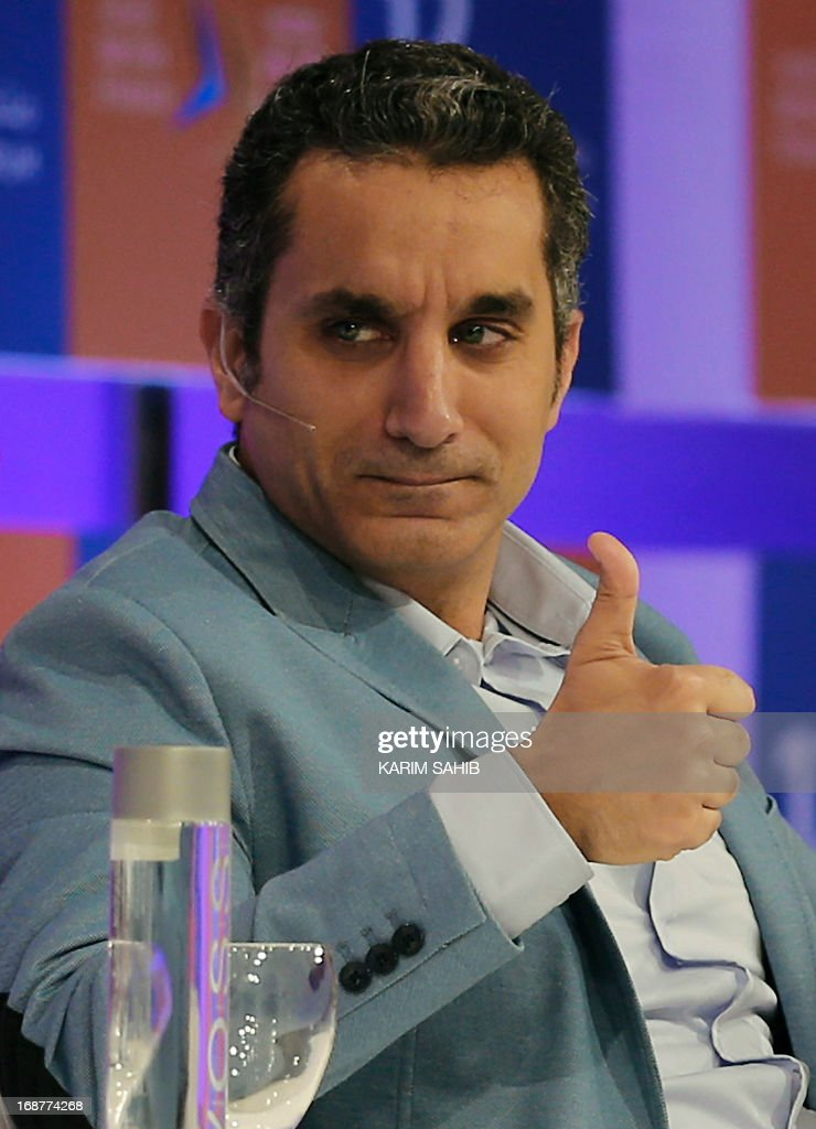 Egyptian satirist and television host Bassem Youssef gestures during the annual Arab Media Forum in Dubai on May 15, 2013, where discussions revolved around the changes and developments in Arab media.