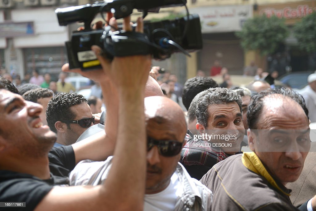 Egyptian satirist and television host Bassem Youssef is surrounded by his supporters upon he arrival at the public prosecutor's office in the high court in Cairo, on March 31, 2013. Youssef was questioned by prosecutors over alleged insults to the president and to religion, reigniting calls for freedom of expression in post-revolt Egypt.