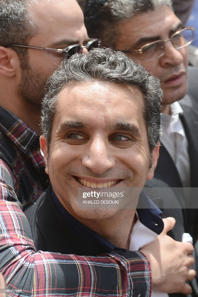Egyptian satirist and television host Bassem Youssef is surrounded by his supporters upon his arrival at the public prosecutor's office in the high court in Cairo, on March 31, 2013. Youssef was questioned by prosecutors over alleged insults to the president and to religion, reigniting calls for freedom of expression in post-revolt Egypt.