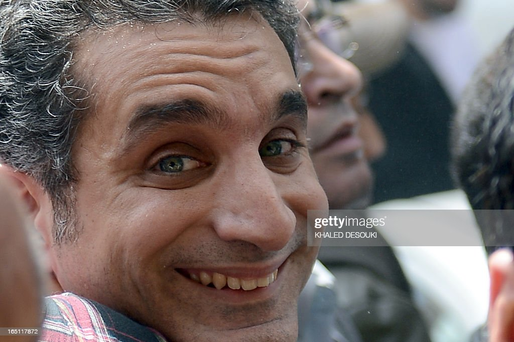 Egyptian satirist and television host Bassem Youssef is surrounded by his supporters upon his arrival at the public prosecutor's office in the high court in Cairo, on March 31, 2013. Youssef was questioned by prosecutors over alleged insults to the president and to religion, reigniting calls for freedom of expression in post-revolt Egypt. AFP PHOTO / KHALED DESOUKI