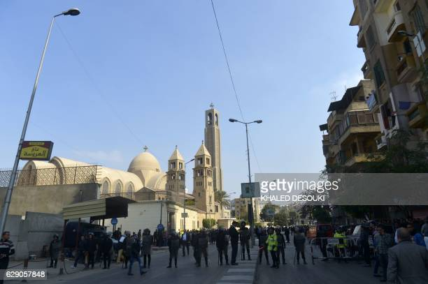Egyptian security forces and onlookers gather outside the Saint Peter and Paul Coptic Orthodox Church which is adjacent to the Saint Mark's Coptic...