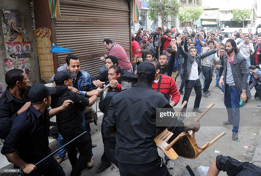 Egyptian security forces clash with protesters who gathered in support of a prominent secular activist who turned himself after being ordered...