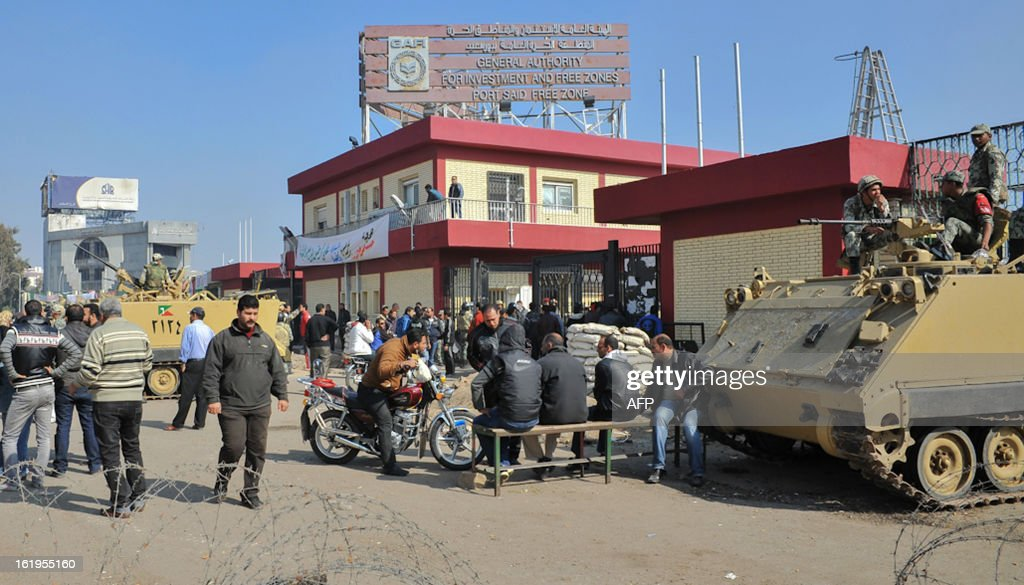 Egyptian security forces guard the entrance of the Port Said free zone authority in the Suez Canal port city on February 18, 2013, as government offices and factories were closed down in the area in demand of justice for dozens of people killed in clashes with police. Demonstrators the previous day also shut down schools and banks and blocked a main railway route, but their protests did not impact traffic through the strategic Suez Canal, a canal official said. STR