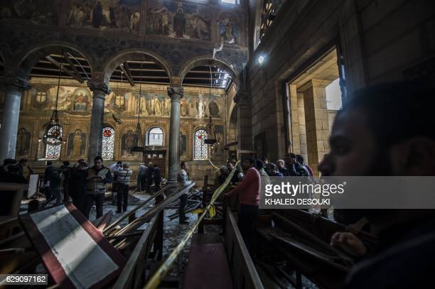 Egyptian security forces inspect the scene of a bomb explosion at the Saint Peter and Saint Paul Coptic Orthodox Church on December 11 in Cairo's...