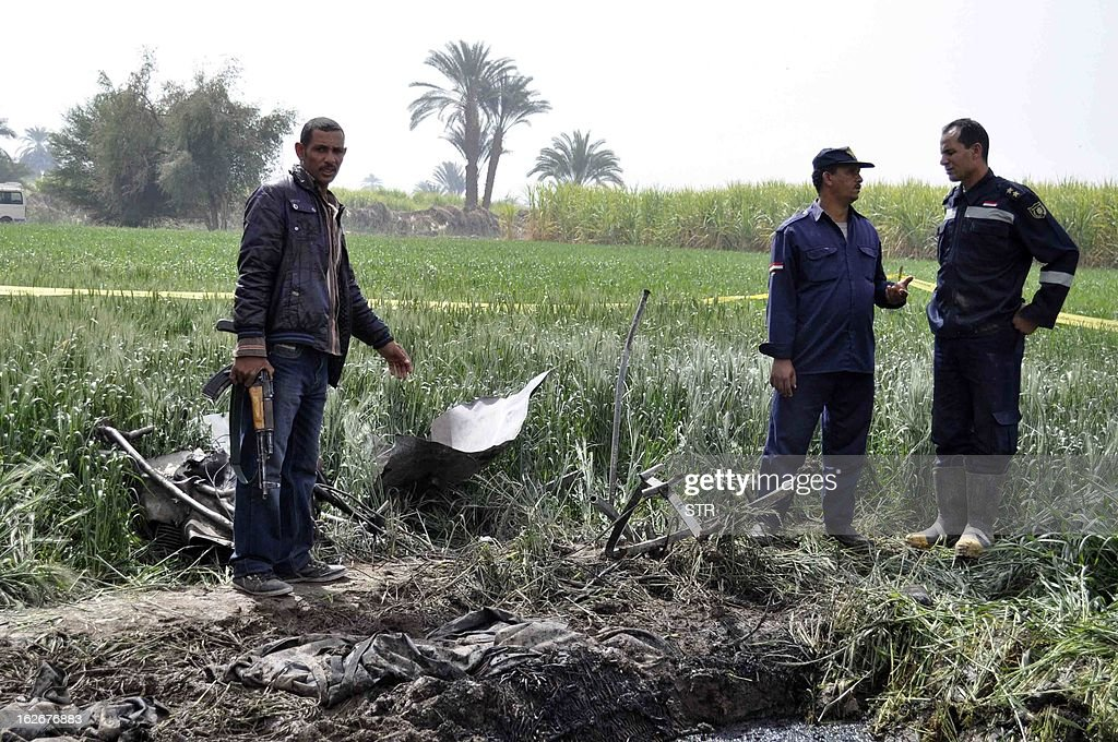 Egyptian security forces inspect the site where a hot air balloon exploded over the ancient temple city of Luxor on February 26, 2013. The hot air balloon caught fire and exploded over Luxor during a sunrise flight, killing up to 19 tourists, including Asians and Europeans, sources said. The balloon carrying 21 people was flying at 300 metres (1,000 feet) when it caught fire, a security official said. AFP PHOTO/STR