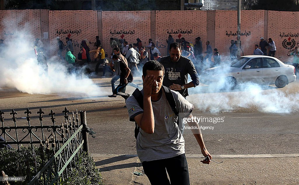 Egyptian security forces intervene to the protestors by using tear gas upon the demonstration under named 'Massacre of the Century' marking the day...
