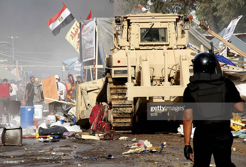 Egyptian security forces move in to disperse a protest camp held by supporters of ousted president Mohamed Morsi and members of the Muslim...