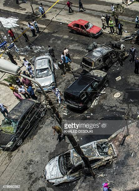 Egyptian security forces stand guard at the site of a bomb that targeted the convoy of the Egyptian state prosecutor Hisham Barakat in the capital...
