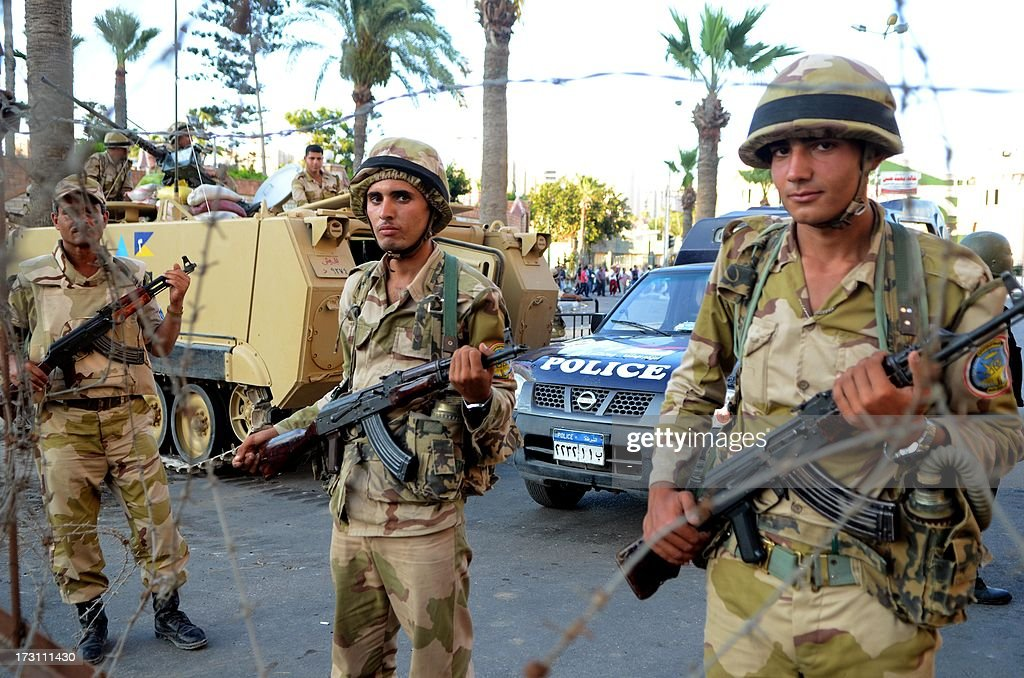 Egyptian security forces stand guard during a demonstration against deposed president Mohamed Morsi on July 7, 2013 in the northern Egyptian city of Alexandria. In the capital, opponents of Morsi packed Tahrir Square in their tens of thousands to show the world his ouster was not a military coup but the reflection of the people's will. AFP PHOTO/ STR